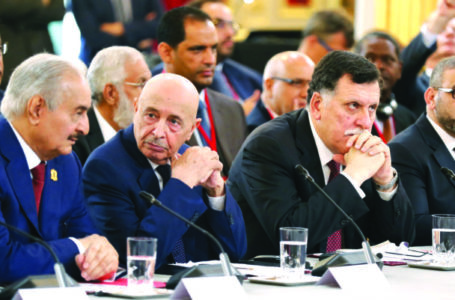 (From L) Libyan National Army's Field Marshal Khalifa Haftar, Libya's parliament speaker based in the eastern town of Tobruk Aguila Saleh Issa, Libya's Presidential Council of the Government of National Accord Fayez al-Sarraj, and President of the High Council of State of Libya Khaled Mechri attend an International Congress on Libya at the Elysee Palace in Paris, on May 29, 2018. Rival Libyan leaders vying for influence in the fractured and war-scarred country meet in Paris for a major peace conference seen as a risky French-backed push for a political settlement in the country. / AFP PHOTO / POOL / Etienne LAURENT